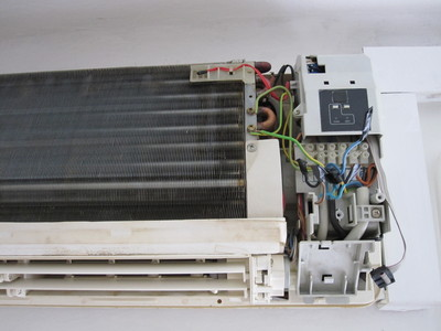 Airwell air conditioning unit with the cover removed.