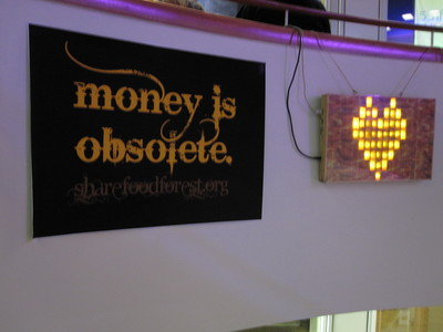 Money is obsolete poster and blinkenlights at 28C3