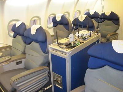 Aircraft meal cart full of spectrum sensing equipment.