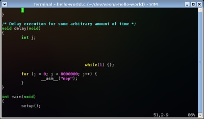 Modified hello-world.c opened in vi.