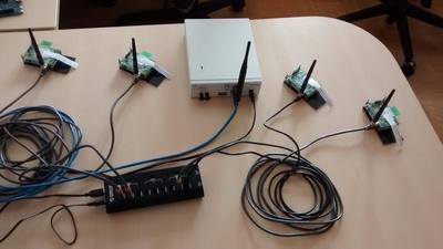 A desk-top setup for SpectrumWars with VESNA sensor nodes.