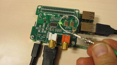 HiFiBerry board with a near-field probe over the resonators.