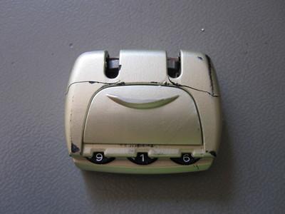 Broken luggage combination lock.