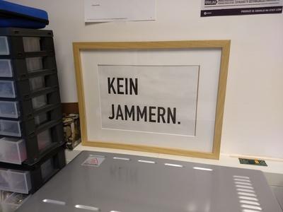 """""""Kein Jammern"""" poster."""