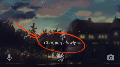 """Charging slowly"" on the bottom of Android lock screen."