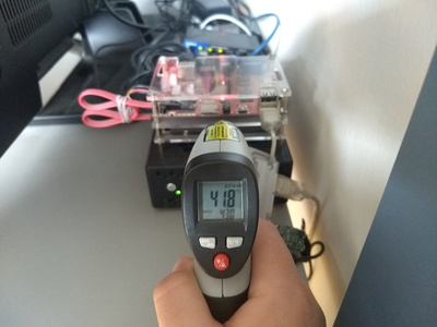 Measuring the CPU temperature with an IR thermometer.