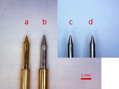 Pogo pin tip comparison under a microscope.