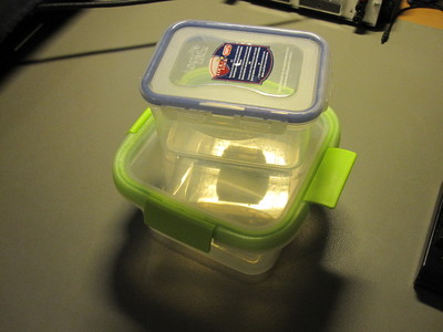 Two types of clear plastic polypropylene food containers.